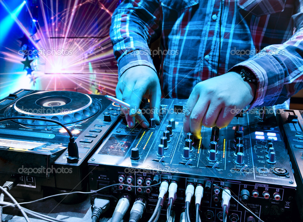 Dj mixes the track in the nightclub — Stock Photo ...
