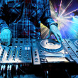 Dj mixes the track in the nightclub - Stock Photo