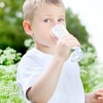 Child drinking pure water — Stock Photo