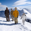 Snowboarders in the mountains - Stock Photo