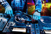 Dj mixes the track in the nightclub — Stock Photo