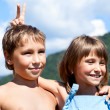 Portrait of two smiling children on nature - Stock Photo