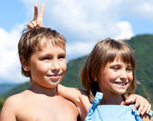 Portrait of two smiling children on nature — Stock Photo