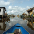 Canoeing through African village — Stock Photo