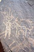 Antiga arte rupestre no níger, representando uma figura e animal — Foto Stock
