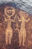 Antiga arte rupestre no níger, representando duas figuras humanas — Foto Stock