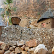 Stock Photo: Traditional Dogon granary below cliff face