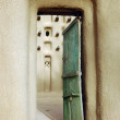 Vertical image of a door into a mud mosque in a Dogon village — Stock Photo
