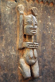 Traditional Dogon carved figure on a door — Stock Photo
