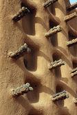 Pared lateral de la mezquita de barro dogon — Foto de Stock