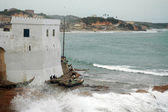 Wave breaking in front of Cape Coast castle — Stock Photo