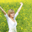 Happy girl in flower field — Stock Photo