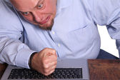 Angry man in front of computer — Stock Photo