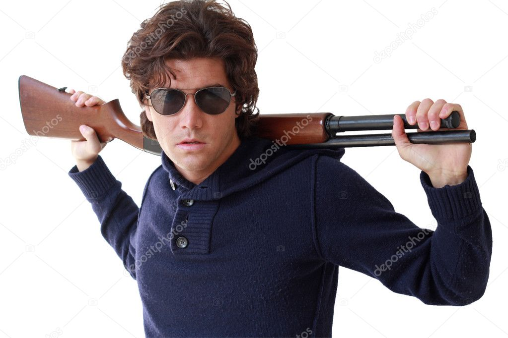 Young guy a little bully with rifle on shoulders. Isolated  Stock Photo #9332830