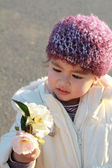 Adorable child looking at flowers — Stock Photo