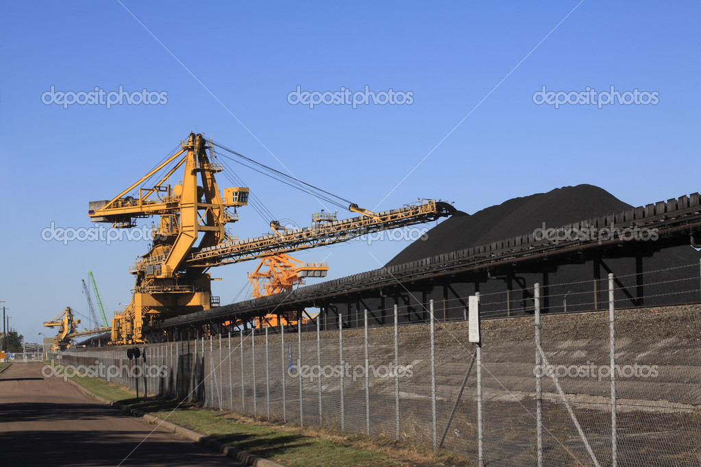 A huge coal loading conveyor belt piles coal. Kooragang Island, Newcastle, NSW, Australia  Stock Photo #9167960