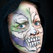 Stock Photo: Young womwith Halloween face painting