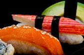 Four sushi on a black background — Stock Photo