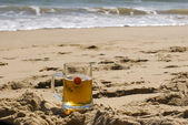 Beer on sandy beach — Stock Photo