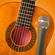 Guitar and a microphone — Stock Photo