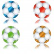 Four multi-colored footballs — Imagen vectorial