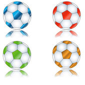 Four multi-colored footballs — Stock Vector