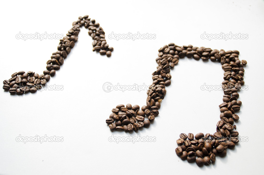 Grains of coffee are mixed together to create musical notes — Stock Photo #9354413