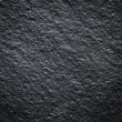 Black wall stone background — ストック写真