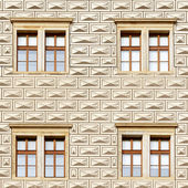 Pattern brick model on building with windows — Stock Photo