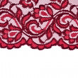Stock Photo: Red lace with pattern on white background