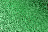 Green metallic plastic texture — Stock Photo