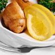 Snail with a lemon on plate - Stock Photo