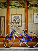 Bike in front of the workshop shoemaker — Stock Photo