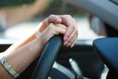 Female hands on wheel — Stock Photo
