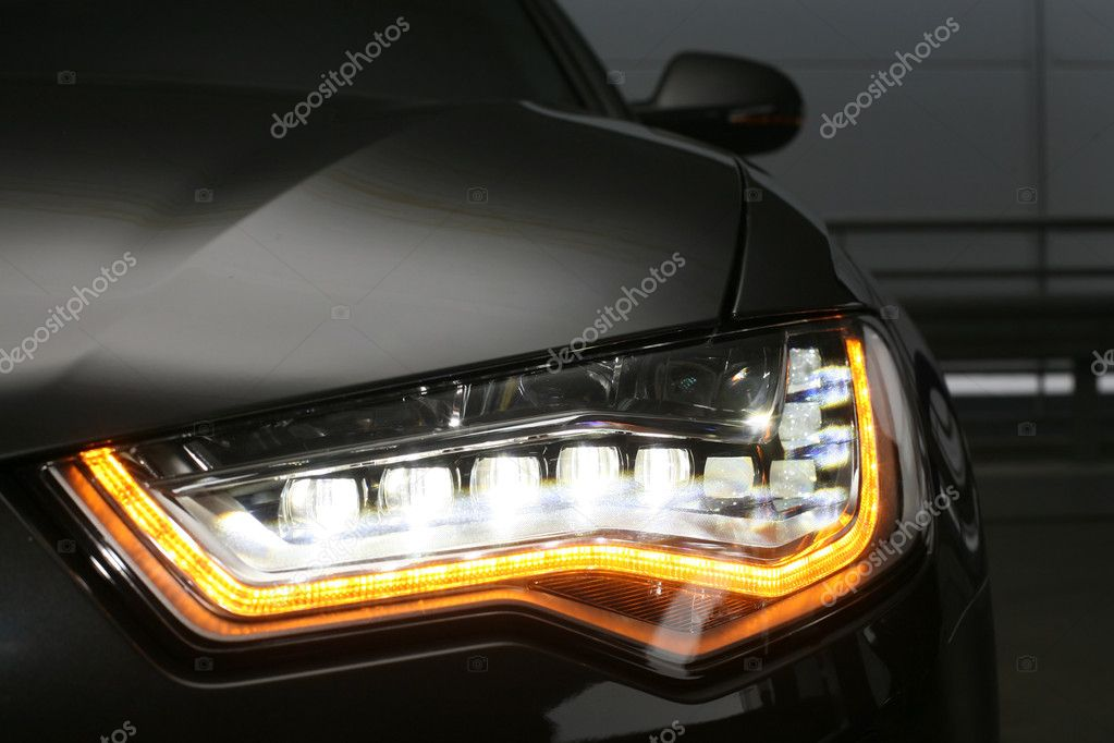 Headlight of  modern prestigious car close up  Stock Photo #10233788