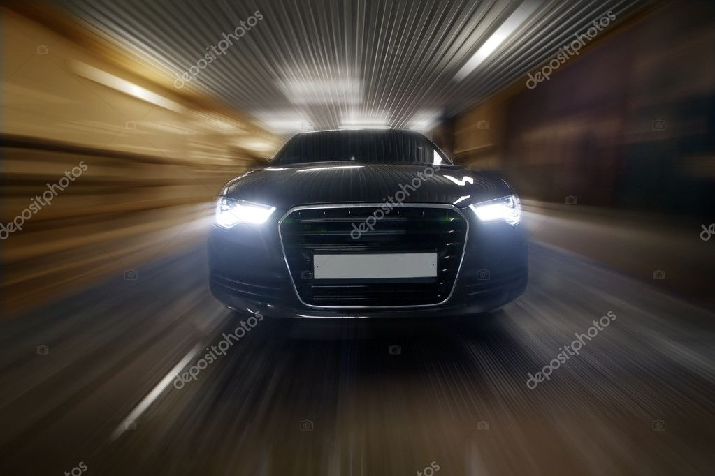 Prestigious car goes in city tunnel — Stock Photo #10487502