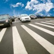Stock Photo: Cars stopped on pedestricrossing