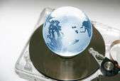 Globe on hard disk — Stock Photo