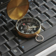 Compass on laptop — Stock Photo #9701288