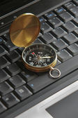 Compass on laptop — Stock Photo