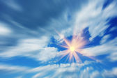 Flight to the sun in the beautiful blue sky — Stock Photo