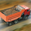 Dump truck goes on road — Stock Photo