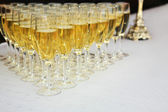 Champagne glasses on a table — Stock Photo