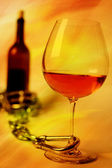 Glass wine and bottle — Stock Photo