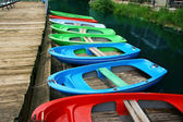 Colour boats at landing stage ashore — Stock Photo