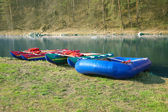 Catamarans and inflatable boat ashore — Stock Photo