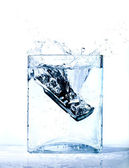 Mobile phone in water — Stock Photo