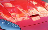 Cowl of red sports car — Stock Photo
