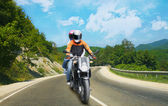 Two go on motorcycle on mountain road — Stock Photo