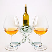 Glasses of light wine chain and bottle — Stock Photo